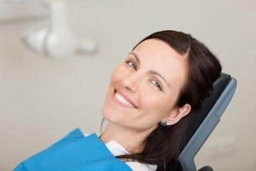 patient in dentist chair after oral surgery