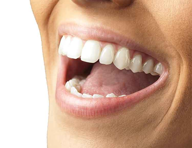 happy patient after full mouth reconstruction